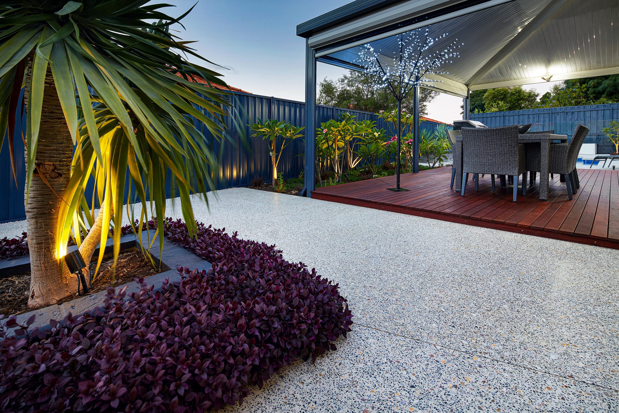 Honed concrete outdoor patio surrounding modern garden
