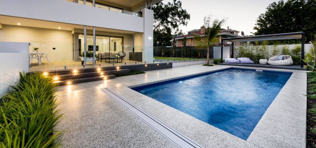 Residential pool with minimal honed concrete edge