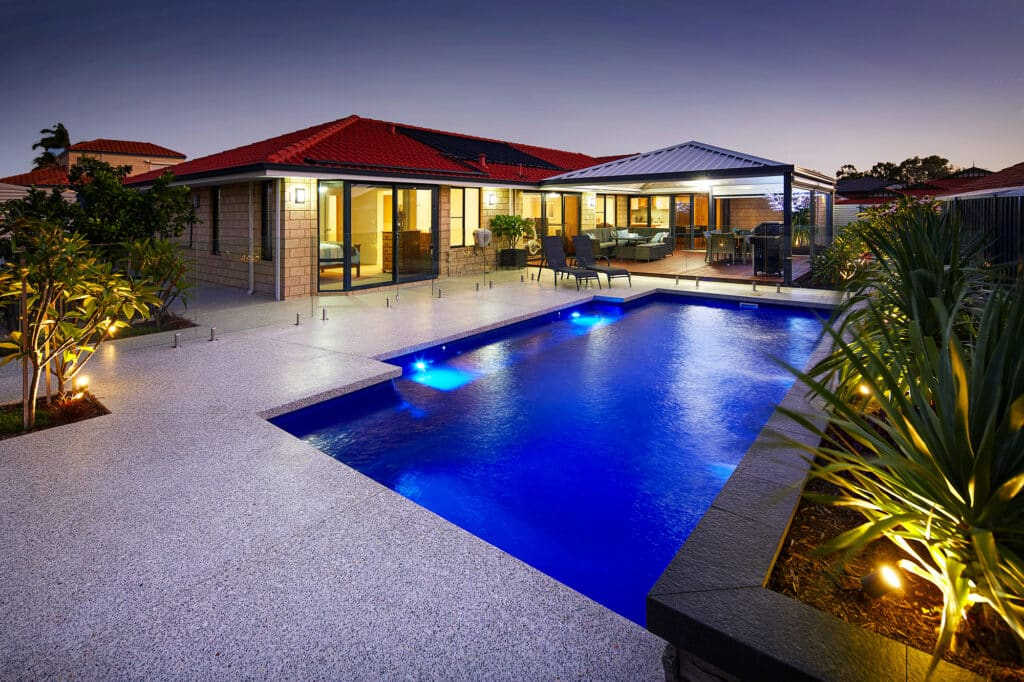Residential pool with minimal honed concrete pool edge