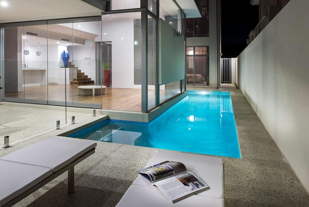 Concrete alfresco area with concrete pool edge
