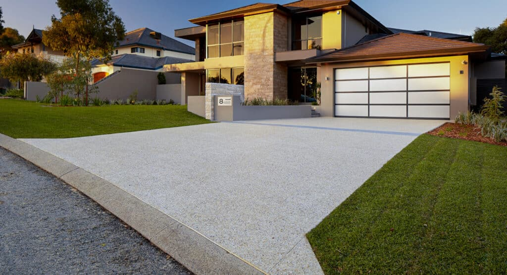 Exposed aggregate driveway in front of modern Perth home