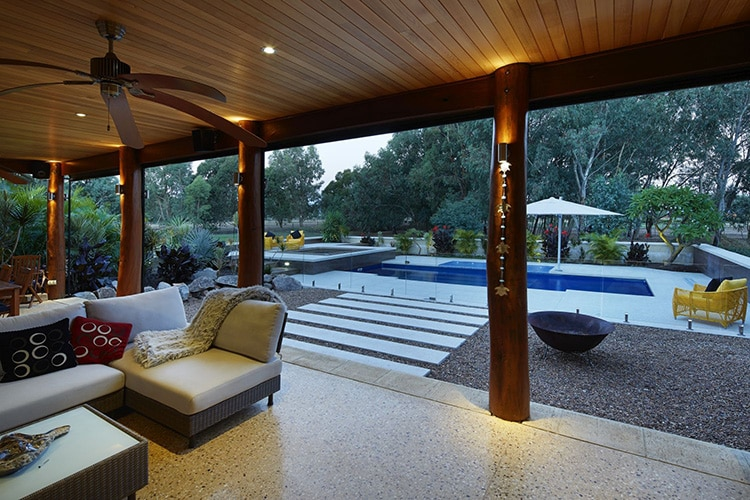 Honed concrete alfresco area overlooking concrete pool edge