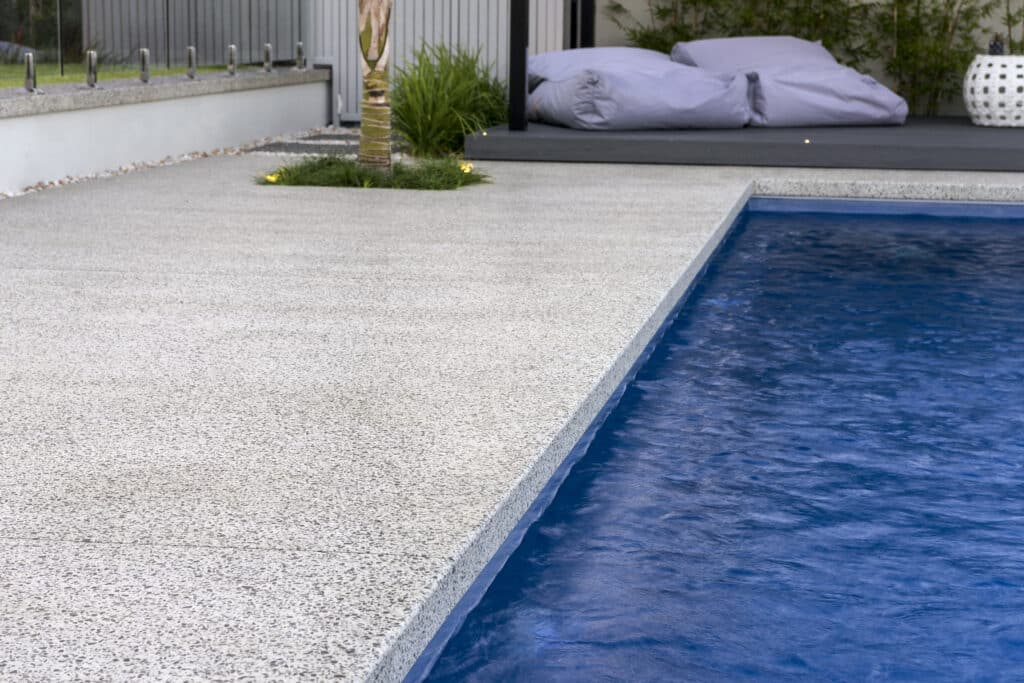 Seamless Concrete Pool Edge leading to undercover alfresco