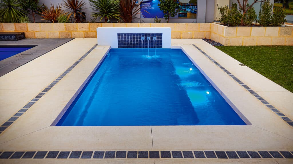 Liquid limestone pool surround with tiled inlay