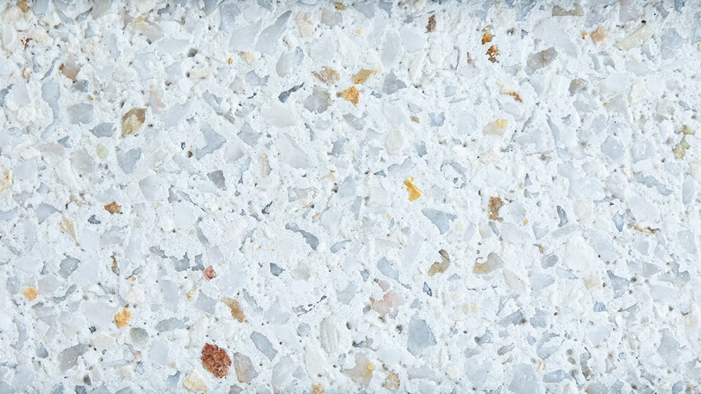Swatch of Coral exposed aggregate concrete